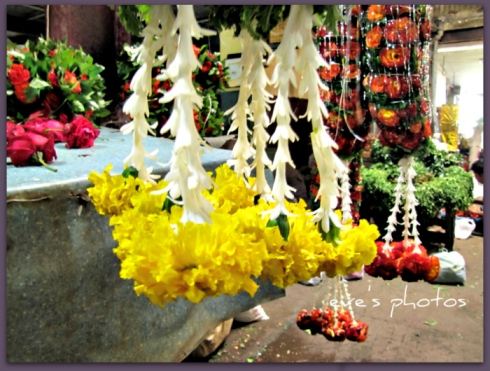 the garlands strung and waiting to be bought. this is a daily event. They will probably be sold by afternoon..