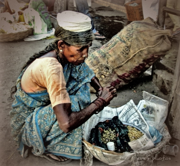 the street vender - I wonder what she is thinking?