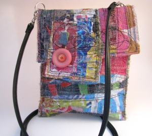 boho bag with pink button. This idea is so easy to copy on to any handbag. :)