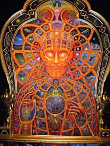 Cosmic Christ was created between 1999 and 2000 with oil paints on a wood surface by artist Alex Grey. It is surrounded by and part of a carved wooden frame. It is presently the centerpiece of the Chapel of Sacred Mirrors in New York, his personally created sanctuary for the inspiration of other artists. It is not only a wonderful representation of the work that he does, but an incredibly powerful and symbolic piece of art.